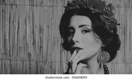 Portrait of a beautiful woman in a wreath. Black and white photography