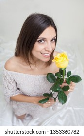 portrait of a beautiful woman with yellow rose