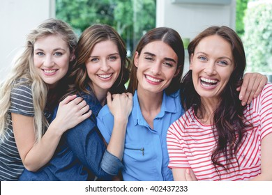 Portrait of beautiful women sitting together at home