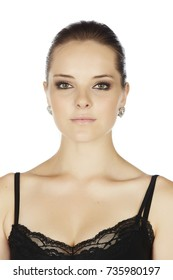 Portrait of a beautiful young adult caucasian woman with dark hair on a light, white background with a black lace top