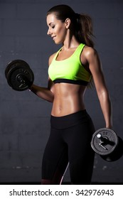 Portrait of a beautiful young adult sporty attractive sexy and sensuality pretty brunette woman at the gym