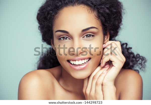 Portrait of a beautiful young African woman smiling.