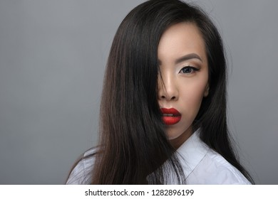 Portrait of beautiful young asian girl in white blouse