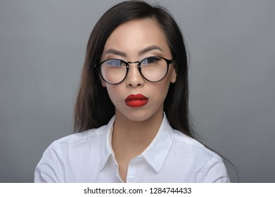 Portrait of beautiful young asian girl with glasses in white blouse