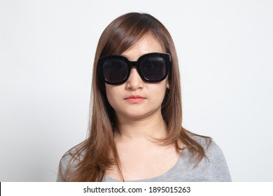 Portrait of a beautiful young asian girl in sunglasses on white background