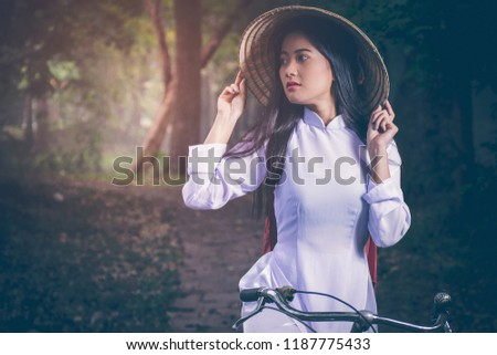 Portrait Of Beautiful Young Asian Teen With Long Hair Wearing A Costume Of Viet Nam
