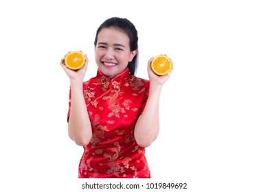 Portrait of Beautiful Young asian woman wear chinese dress traditional cheongsam or qipao. holding juicy orange on white background, healthy, Chinese New Year Festivities, New Year Celebration