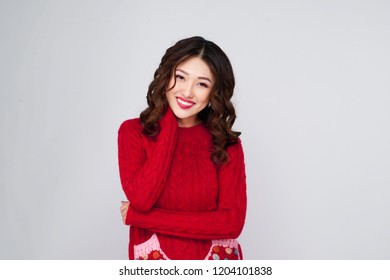 Portrait of a beautiful  young asian woman in warm clothes