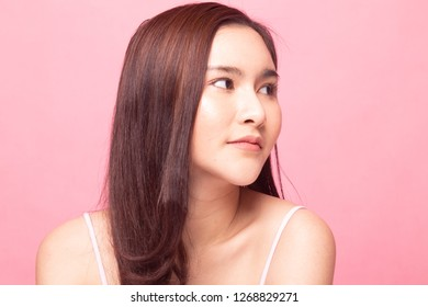 Portrait of beautiful young Asian woman on pink background