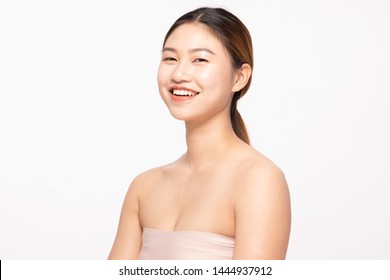 Portrait Of Beautiful Young Asian Woman Smiling Gesturing so happy and cheerful with healthy Clean and Fresh skin,isolated on white background,Beauty Cosmetology Concept
