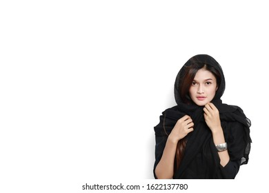 Portrait of a beautiful young asian woman in black dress is covered with black cloth, Beautiful witch, Clipping path.