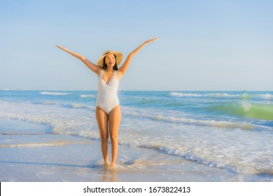 Portrait beautiful young asian woman happy smile around sea ocean beach and blue sky for leisure travel vacation