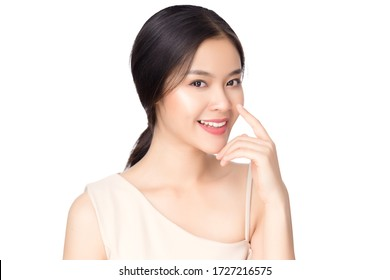 Portrait beautiful young asian woman nose surgery  concept. Asian girl beauty face skin care and health wellness, Facial treatment, Perfect face shape, hand touching nose, on white background.