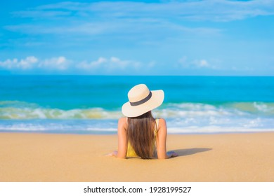 Portrait beautiful young asian woman relax smile leisure around outdoor tropical sea beach ocean in travel vacation
