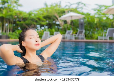 Portrait beautiful young asian woman leisure relax smile around outdoor swimming pool for vacation