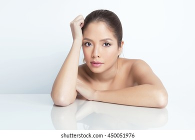 portrait of beautiful young asian woman with flawless skin