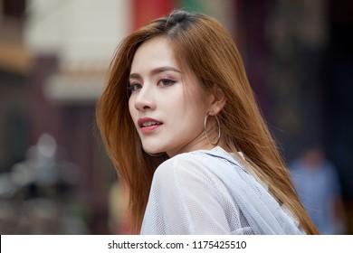 portrait of beautiful Young Asian women tourist traveler smiling in China town Yaowarat city bangkok thailand . street fashion