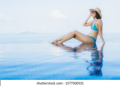 Portrait beautiful young asian women happy smile relax outdoor swimming pool in resort hotel for vacation travel