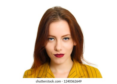 Portrait of beautiful young attractive woman standing in front of white background and looking at you with her wonderful blue eyes