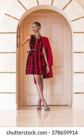 Portrait of a beautiful young black woman in red dress fashion outfit