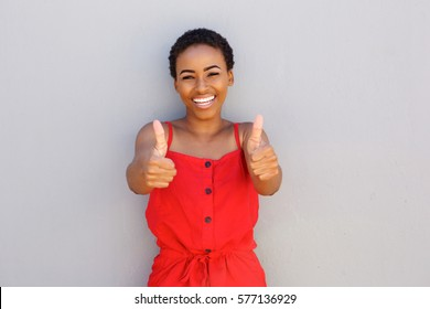 Portrait of beautiful young black woman smiling with thumbs up hand gesture