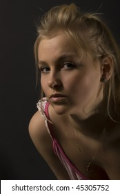 Portrait of a beautiful young blond fashionable woman