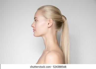 Portrait Of Beautiful Young Blond Woman With Ponytail Hairsty?le. Side View