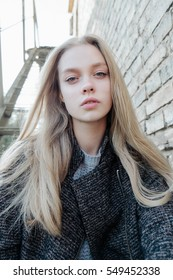 portrait of a beautiful young blonde in the autumn sun walk, model test
