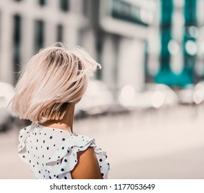 Portrait Beautiful young blonde girl in modern hat with full lips  posing and smiling on  the street lifestyle  on sunny day