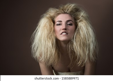 Portrait of a beautiful young blonde woman with a magnificent hairstyle smiling and posing on a dark background. Shooting beauty concept. Concept of discounts and sales in women's stores. Copyspace