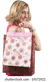 Portrait of a beautiful young blonde woman wearing a pink fashionable top and holding shopping bags over her shoulder. Isolated on white background