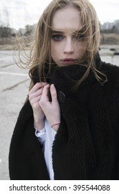 portrait of a beautiful young blonde woman in a black jacket