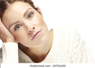 Portrait of a beautiful young bored woman on a white background