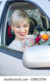 Portrait of a beautiful young bride in the car