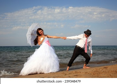 portrait of a beautiful young bride and groom at the beach