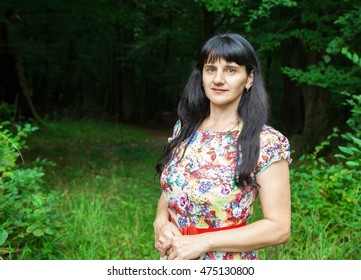 portrait of a beautiful young brunette in a forest