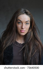 portrait of beautiful young brunette girl with no make-up