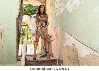Portrait of a beautiful young brunette posing in an abandoned location