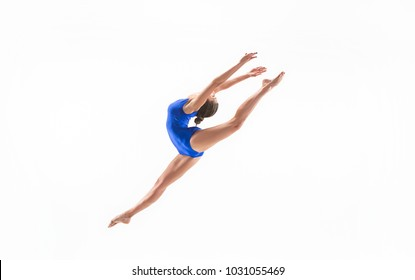 The portrait of beautiful young brunette woman gymnast training calilisthenics exercise with acrobatic element on white studio background. Art gymnastics concept. Caucasian model in full height
