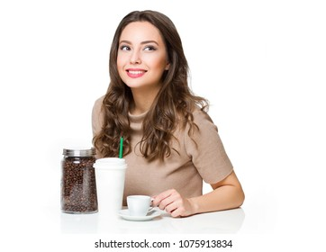 Portrait of a beautiful young brunette woman having coffee.