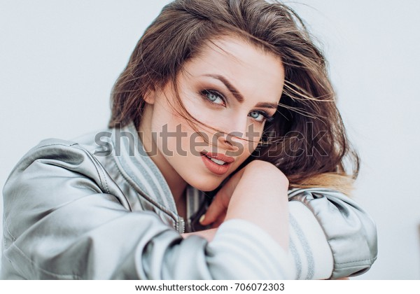 Portrait of beautiful young brunette woman with makeup