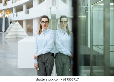 portrait of the beautiful young business lady wearing spectacles and shirt