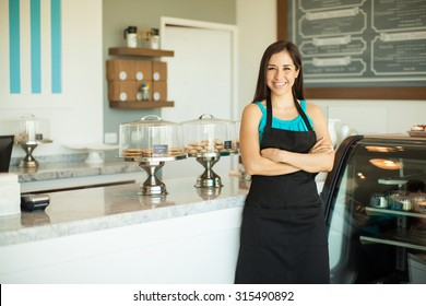 Portrait of a beautiful young business owner standing in front of her bakery and smiling