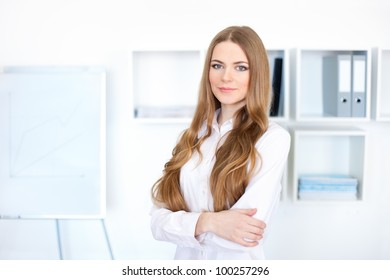 Portrait of beautiful young business woman in bright office