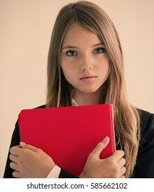 Portrait of a beautiful young businesswoman with folder