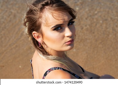 Portrait of Beautiful Young Caucasian Girl with Barbell septum Nose Ring. Horseshoe Nose Ring.