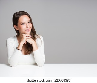 Portrait of a beautiful young cheerful brunette woman.