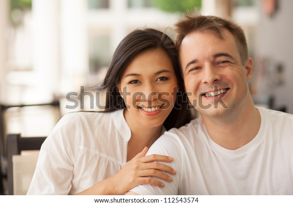 Portrait of beautiful young couple looking at camera