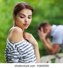 portrait beautiful young couple man woman quarreled background summer green park