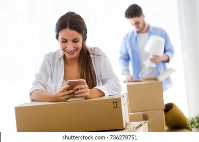 Portrait of beautiful young couple moving at new home.